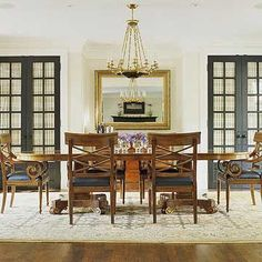 Double French Doors  Interior doors create an illusion of space beyond, even when they open up to china cabinets. Old-fashioned 12-paned glass-panel doors are backed with sheer curtains to hide the closet contents.