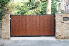 Sliding Driveway Gate. Contemporary style driveway gates made from rough Iron and redwood http://gateforless.com/product-category/gate/residential/contemporary-modern/