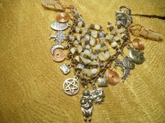 Beautiful One of a Kind Artisan Hand Crafted Goddess Bracelet with Pewter Venus of Willendorf Goddess Charm, Handmade Copper Spirals of Life, Hand Wire Wrapped Copper and Crystal Points, Opals, Moonstones, Pink Quartz, and Pewter Charms Number 1 in Limited Edition Series by MelancholyMind, $39.99