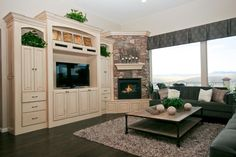 built-in entertainment centers | Entertainment center meets fireplace...