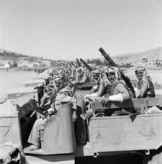 George Rodger 1941  Amman. Bren gun carriers of the Desert patrol ( a spin-off of the Arab Legion).