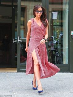 Bold: Victoria Beckham made a statement in red when she left the Crosby Hotel in New York in a leggy dress on June 3, 2015