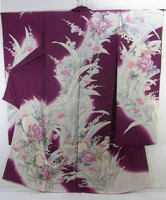 This is a kimono silk fabric cut into Furisode shape and stitched roughly before sewing to make furisode.  It has gorgeous flower pattern, which is dyed.