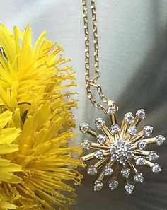 Spread the seeds of kindness with this yellow gold and diamond dandelion necklace.