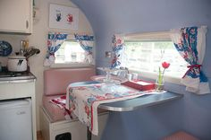 vintage camper...very pretty red and blue interior