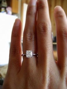 Beautiful radiant cut solitaire with skinny white gold band