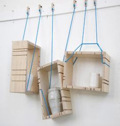 wooden hanging shelves...ml: I could do this with the wooden crates from Apack. Noice!!