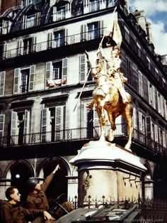 A Sgt. and Cpl. stop on their way through Paris to look at the famous statue of Joan of Arc. Immediately after the Germans evacuated Paris, ...