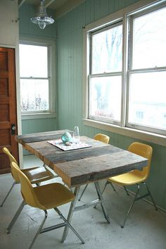 #wood #table and yellow #chair