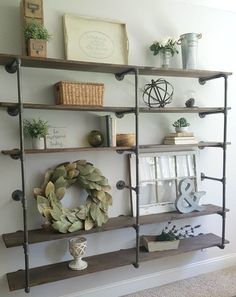DIY industrial pipe shelves styled with neutral farmhouse decor