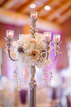 candelabra , love the idea of this but maybe with a more Gothic look, deep burgundy flowers and a candelabra that is slightly tarnished