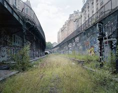 Among the rusting vestiges of Europe's Industrial Revolution, this 20-mile relic of a railroad in Paris has been abandoned since 1934, and while it has been retaken by nature in the ensuing decades...
