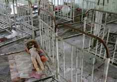 A doll is seen amongst beds at a kindergarten in Ukraine's ghost town of Pripyat, in April 2006