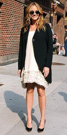 JULIA ROBERTS dressed to frill, topping a cream shift with a black blazer.