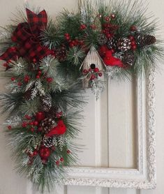 Check out these awesome last minute DIY Christmas decorations on a budget that will brighten your home over the festive season. Picture frame wreaths are really cheap and easy holiday decor ideas that you can use for your indoor or outdoor decorations. Christmas Swags, Noel Christmas, Holiday Wreaths, Rustic Christmas, Christmas Ornaments, Holiday Decor, Winter Wreaths, Christmas Door Wreaths, Christmas Flowers