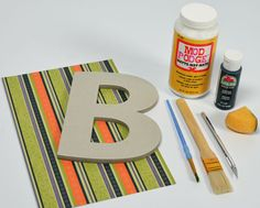 Simple, inexpensive Mod Podge project using  chipboard letters and scrapbook paper.