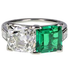 Cartier Antique Colombian Emerald Diamond Two Stone Ring | From a unique collection of vintage more rings at https://www.1stdibs.com/jewelry/rings/more-rings/