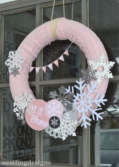 Snowflake #wreath made using a pool noodle, sweater from goodwill, and some ornaments!  #snowflake #party