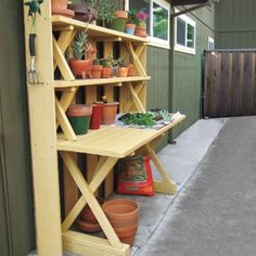 A painted picnic table can quickly be converted into a great workspace while the stacked benches on top provide some clever shelving for storage.