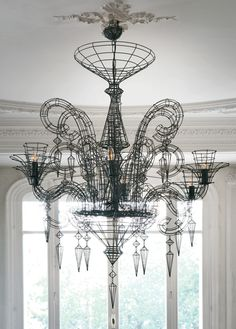 We love the use of this unique wire chandelier; teamed with a free-standing tub, it lends a sophisticated focal point to the bathroom space. #DesignIdeas