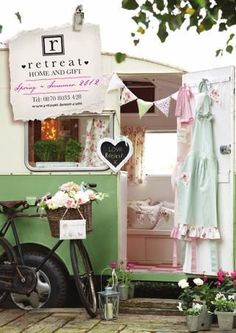 Love this caravan display - good use of props (bicycle, bunting and potted flowers all add to the vibe)