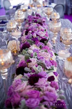 For a purple wedding - a fabulous tablerunner of a mix of blooms in a variety of purple hues ~ http://www.modwedding.com/galleries/reception-decor/
