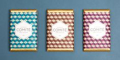 """Comité Studiouses a block pattern with a touch of gold to best describe  the sensation you get when biting into a bar of theirchocolate. Letter  tiles are spread across the surface overlapped with a hexagon label. Upon  tearing its wrapping, the confection does not disappoint as it brings  smiles to consumer's faces from a riptide of deep setimpressions.   """"We made a limited edition of chocolates to thank our customers and friends  for their confidence in us. Our work began with the ..."""
