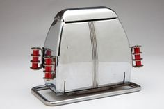Rare Art Deco chrome and Red Bakelite Trim Toaster. Made in the 1930's by Superior Electric Product Corp. in St. Louis, MO.
