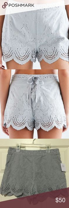 NWT [Kimchi Blue] Blue Hailey Scallop Short - Sz 6 BRAND NEW, never worn. Scalloped lace cotton short by Kimchi Blue with a lace-up ribbon detail at the back. In a mid-rise fit with pockets and a hidden zip closure at the side. Purchased from Urban Outfitters. Urban Outfitters Shorts