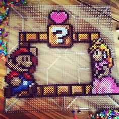 Mario Bros photo frame perler fuse beads by kikiskreations. Melty Bead Patterns, Hama Beads Patterns, Beading Patterns, Pixel Art, Perler Bead Mario, 8bit Art, Peler Beads, Iron Beads, Melting Beads