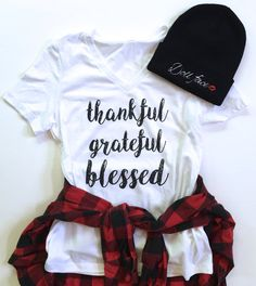 BACK IN STOCK! Our *thankful grateful blessed* design has been screen printed on a white relaxed-fit v-neck tee!   PLEASE READ>> PRODUCT DETAILS: *Doll Face Clothing Co. original design / Bella + Canvas tees *Womens relaxed-fit v-neck (not slouchy) *True to size/ slightly relaxed *Available in sizes S-XL *PLEASE SEE SIZE/MEASUREMENTS:  Length: Bust: Sleeve length: S 26.13 33.5 7.5 M 26.75 36.5 8 L 27.38 40.5 8.75 XL 28 44.5 9.25 *NOTE: Size chart is from the Bella + Canva...