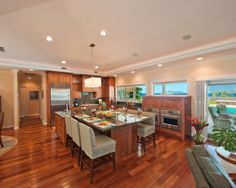 Beautiful hard wood floors, contemporary cabinets, unique double oven wall under the window, granite counters, stainless appliances #home #remodel #kitchen #bathroom #interiors www.jimhicks.com