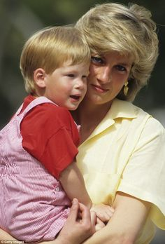 Mother and son: The 31-year-old says he hopes his charity work is something that honors his mother's memory. Princess Diana pictured holding her son in Majorca in 1987