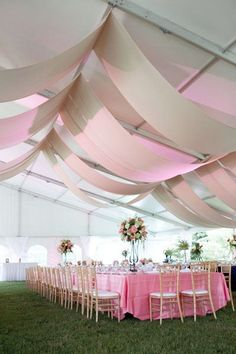 If you want high ceilings but want to create an intimate feel with your guests incorporate these hanging drapes in your #tentdecor #outdoorreception #tentwedding