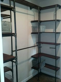 Industrial closet... Constructed from gas pipe. Can't wait to fill this!