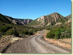 Dirt road through the veld near Steytlerville -- there is mountainous terrain between Steytlerville and Wolwefontein