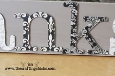 To make this, you will need:    -A wood board    -Wooden or chipboard letters (I used chipboard)    -Coordinating scrapbook paper    -Small clothespins    -Thin wire    -Paint    -Mog Podge