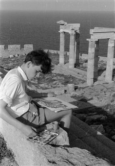 Boy painting a Greek temple     Photographer and date unknown