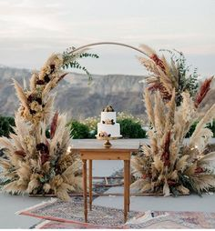 Cliffside Winery Wedding in Santorini with Romantic Pampas Grass Decor - Green W. Cliffside Winery Wedding in Santorini with Romantic Pampas Grass Decor - Green Wedding Shoes Wedding Props, Wedding Cakes, Bohemian Wedding Decorations, Backdrop Wedding, Wedding Sweets, Wedding Centerpieces, Dessert Wedding, Photo Display Wedding, Outside Wedding Decorations