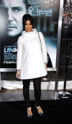 Kim Kardashian Wool Coat - Kim went for a mod look in a white funnel collar A-line coat at the premiere of 'Unknown.'