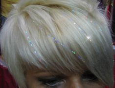 Love the hair tinsel, but mostly just adore the thick, side-swept bangs.