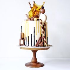 Creative Bakes // Layers of vanilla cake with salted caramel buttercream, upside down drip, salted caramel drip, toffee and mixed nuts sail, peanut butter Lindt balls, Mars bar brownie, broken up flakes, salted caramel popcorn and loads of dark chocolate covered maltesers   cakesbycliff
