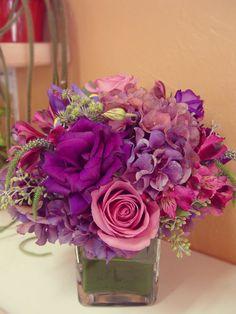 A elegant flower arrangement lavender rose, purple lisanthus, veronicas, alstroemeria, and seeded eucalyptus.