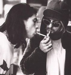 Dave Grohl and Kurt Cobain lighting up. 1990's