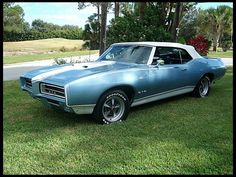 1969 Pontiac GTO Convertible~prettiest damn car i have ever seen.