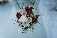 Pale pink roses with white anemones and white dahlias and dark burgundy dahlias and privet berries = winter