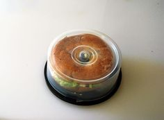 14.) A portable bagel holder made out of CD/DVD tower case.