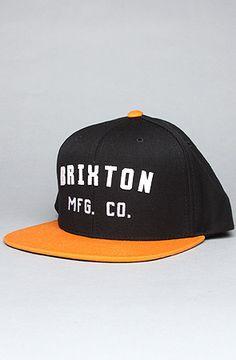 215b05c9b88 Brixton The Arden Hat in Black  amp  Orange Snapback hat with tonal  eyelets
