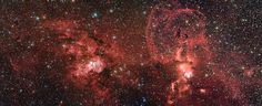 This image, captured by the Wide Field Imager at ESO's La Silla Observatory in Chile, shows two dramatic star formation regions in the southern Milky Way. The first is of these, on the left, is dominated by the star cluster NGC 3603, located 20 000 light-years away, in the Carina–Sagittarius spiral arm of the Milky Way galaxy. The second object, on the right, is a collection of glowing gas clouds known as NGC 3576 that lies only about half as far from Earth.