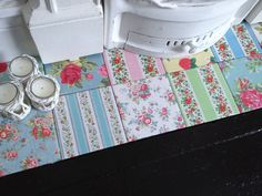Hearth - made using white bathroom tiles decoupaged with Cath Kidston tissue